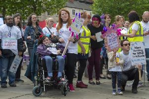Parents' protest over funding for young people with special educational needs and disabilities outside Leeds City Art Gallery.