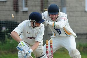 Pudsey St Lawrence wicketkeeper, Charlie Best, celebrates after stumping Tim Jackson of Woodlands for 22 off the bowling of Chris Marsden. But it was 'Woodlands who won by four wickets and now have a lead of 31 points at the top of the division. PIC: Steve Riding