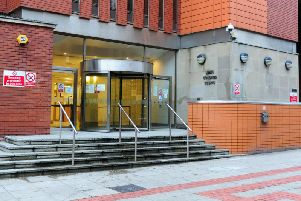Three men are appearing at Leeds Crown Court today