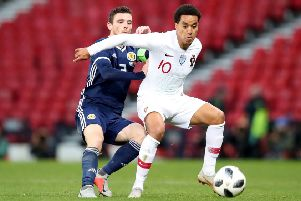 Key target: Portugal's Helder Costa, in action against Scotland, is wanted by Leeds United.