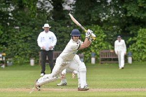 Striking form: 'Steve Bullen, of New Farnley, goes on the attack against Cleckheaton. Picture: Steve Riding