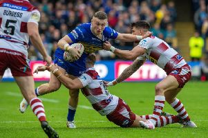 Harry Newman is held by Wigan's George Williams and Oliver Gildart at Headingley last week. PIC: Bruce Rollinson/JPIMedia