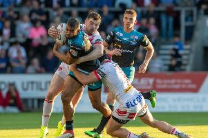 NO GO: Kallum Watkins is held back during Friday night's 36-10 defeat at the Totally Wicked Stadium.' Picture: Bruce Rollinson