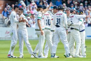 Yorkshire celebrate as Surrey's Ryan Patel is caught behind by Jonathan Tattersall for 26, bowled by Keshav Maharaj, at Scarborough.  Picture: Bruce Rollinson