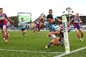 Cronulla's Sosaia Feki scores against Newcastle Knights last season. (Photo:  Cameron Spencer/Getty Images)