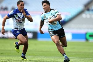 QUALITY: Sosaia Feki of the Sharks runs in for a try for Cronulla Sharks against Canterbury Bulldogs  in September last year. Picture: Mark Metcalfe/Getty Images.