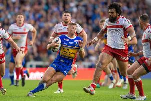 SURROUNDED: Leeds Rhinos' Jack Walker tries to find a way through Hull KR at Headingley. 'Picture: Bruce Rollinson