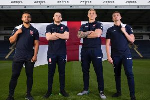 England Knights players Kruise Leeming, Cameron Smith, Mikolaj Oledzki and Jack Walker fly the English flag at Headingley.
