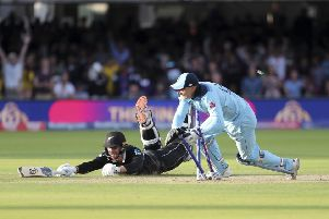 THAT WINNING MOMENT: England's Jos Buttler runs out New Zealand's Martin Guptill to clinch a dramatic victory at Lord's and clinch the country;s first-ever World Cup. Picture: AP/Aijaz Rahi