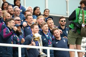 England players pose with the trophy.