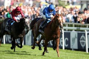 Masar, ridden by jockey William Buick, winning the 2018 Investec Derby. PIC: Adam Davy/PA Wire