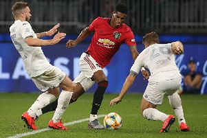 TOO GOOD: Manchester United's England international Marcus Rashford prepares to beat Leeds United duo Stuart Dallas and Gaetano Berardi before doubling his side's lead in Perth. Picture by Paul Kane/Getty Images.