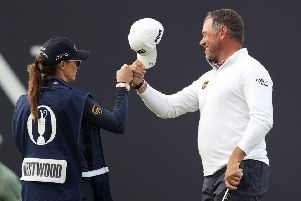 England's Lee Westwood celebrates with his girlfriend and caddie Helen Storey after his birdie on the 18th at Royal Portrush. Picture: David Davies/PA/TheOpen.com