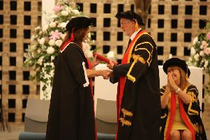 Hannah Thaxter receives an honorary fellowship from Pro-Chancellor John Battle, former Leeds West MP, cheered on by Vice-Chancellor Professor Margaret A House OBE.