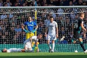 Leeds United's players show their frustration after Swansea City's winning goal.