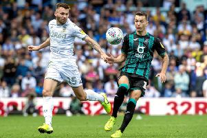 Leeds United's Stuart Dallas and Swansea's Bersant Celina battle for the ball. Picture Bruce Rollinson
