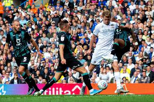 Patrick Bamford and Swansea's Andrew Ayew clash for the ball.