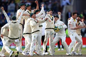 Australia celebrate after they claimed victory to retain the Ashes at Old Trafford. Picture: Mike Egerton/PA