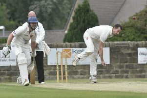 LEADING MAN: Captain James Davies took 6-24 to help Otley clinch the Aire-Wharfe title for the second year in a row. Picture: STEVE RIDING