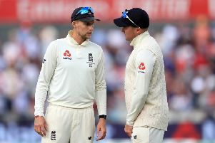 England's Joe Root (left) and Jason Roy discuss tactics on day four at Old Trafford. Picture: Mike Egerton/PA.