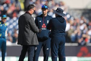 England captain Joe Root (centre), coach Trevor Bayliss (right) and former player Michael Vaughan prior to the start of day five at Old Trafford. Picture: Mike Egerton/PA