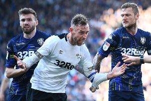 Stuart Dallas and Liam Cooper signed new contracts with Leeds United on Wednesday.