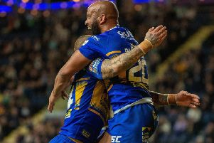 Jamie Jones-Buchanan celebrates scoring Leeds Rhinos' second try against Salford Red Devils.