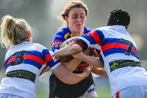 Action from Leeds Rhinos' clash with Wakefield earlier in the season. Sophie Nuttall is tackled by Wakefield's Caitlin Clifton and Emma Ryan.
