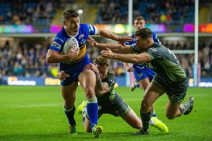 Stevie Ward is held by Blake Austin and Toby King during Friday's Super League tussle at Headingley. 'Picture: Bruce Rollinson