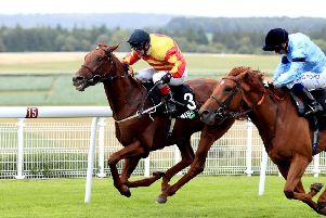 Sir Ron Priestley ridden by Jockey Franny Norton (left) wins the Unibet Handicap during day two of the Qatar Goodwood Festival. Picture: Adam Davy/PA