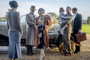 Elizabeth McGovern, from left, Harry Hadden-Paton, Laura Carmichael, Hugh Bonneville and Michael Fox, right, in a scene from Downton Abbey, the film continuation of the series that wowed audiences for six seasons, on release now (Jaap Buitendijk/Focus Features via AP)