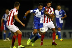 HITTING THE MARK: Bristol Rovers' Jonson Clarke-Harris is challenged by Cheltenham's Conor Thomas earlier this season. Picture: Michael Steele/Getty Images