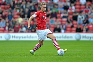 Cauley Woodrow gave Barnsley an early lead against Brentford but the Bees came back to win 3-1.
