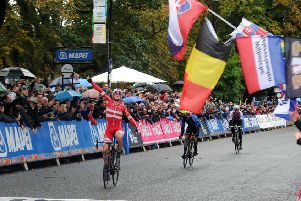 Best in the world: Mads Pedersen of Denmark punchs the air in delight as he crosses the line first to win the UCI Road World Championships elite men's road race in Harrogate yesterday. Pedersen won the rainbow jersey from Matteo Trentin of Italy in second place and Stefan Kung of Switzerland in third. (Picture: Tony Johnson)