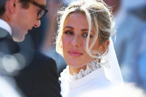 Newly married Ellie Goulding and Caspar Jopling leave York Minster after their wedding. Ellie's lipstick is MAC Lipstick in Whirl, �17.50. Picture: James Hardisty/PA Wire