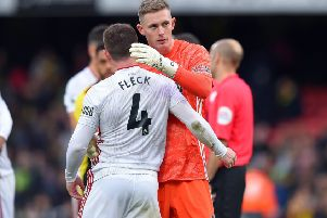 Top display: John Fleck congratulates Sheffield United goalkeeper Dean Henderson at Vicarage Road. Picture: Robin Parker/Sportimage