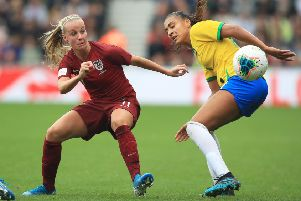 From the stands to the pitch: Middlesbrough supporter England's Beth Mead, left, takes on Brazil's Feitoza Kathellen at the Riverside Stadium.