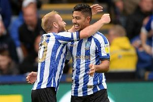 Massimo Luongo congratulated by his skipper Barry Bannan. Pictures: Steve Ellis