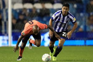 Sheffield Wednesday's Massimo Luongo (right) and Everton's Fabian Delph battle for the ball last month. Picture: Simon Cooper/PA