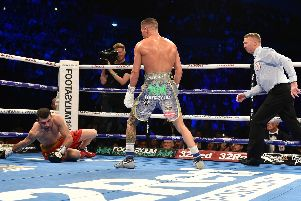 Josh Warrington knocks Sofiane Takoucht to the floor. PIC: Steve Riding.