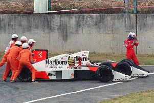 Off circuit: Ayrton Senn and bitter rival Alain Prost after their collision in Suzuka. Picture: Getty Images