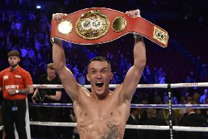 Josh Warrington shows off his IBF Featherweight title belt after his stunning second-round stoppage of Sofiane Takoucht. Picture: Steve Riding.