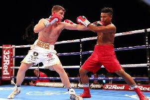 Dominant: Reece Mould, left, and Bayardo Ramos in Leeds  Arena action.