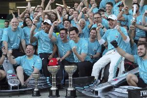 Champions: Winner Valtteri Bottas, right in white cap, and third-placed Lewis Hamilton , left in white cap, celebrate with Mercedes crew.
