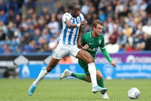 Terence Kongolo: Defender, left, returns to bolster Huddersfield Town's ranks for the trip to Blackburn Rovers. (Picture: Martin Rickett/PA Wire)