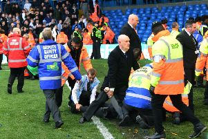 Unwanted scene: Birmingham fans are restrained at full time at Elland Road. 'Picture: Jonathan Gawthorpe