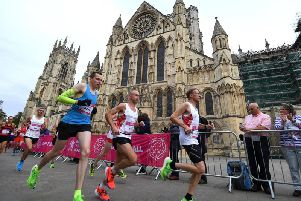 Marathon runners make their way through the city centre for the early stages of the race.