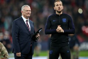 Concerned: FA chairman Greg Clarke, left, with England captain Harry Kane
