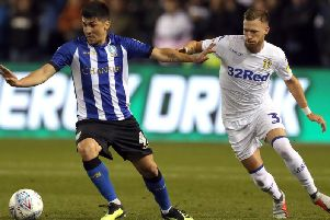 Sheffield Wednesday's Fernando Forestieri (left) and Leeds United's Barry Douglas battle for the ball during the Sky Bet Championship match at Hillsborough last year. Pic: Richard Sellers/PA Wire