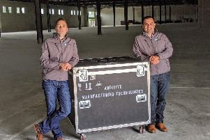 Joseph Crabtree, and Luis Folgar, EVP Americas in the new AMT facility in Austin, Texas.